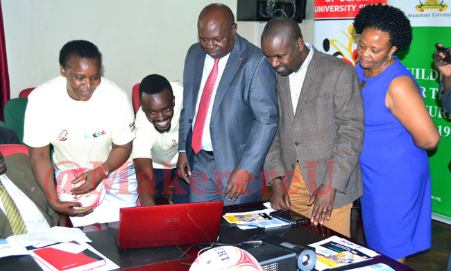 Hon Bakabulindi (Centre) launching the World University Netball Championship 2018 website